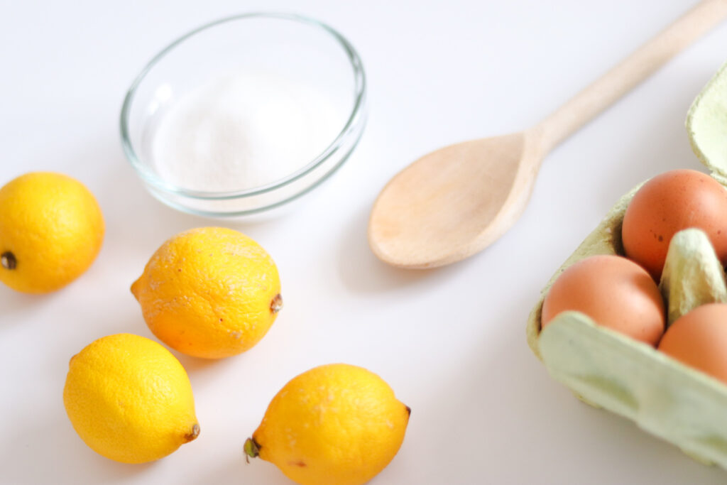 Lemon drizzle cake ingredients. You'll need flour, egg, sugar, lemon and butter.