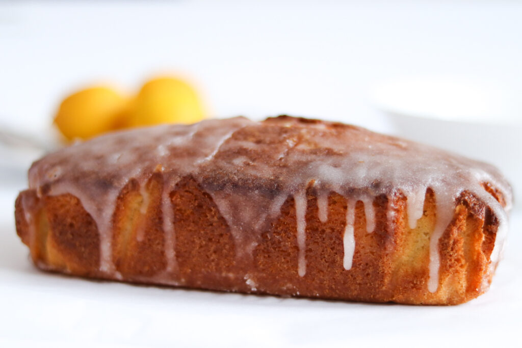 lemon drizzle icing poured over the cake to provide a glaze.
