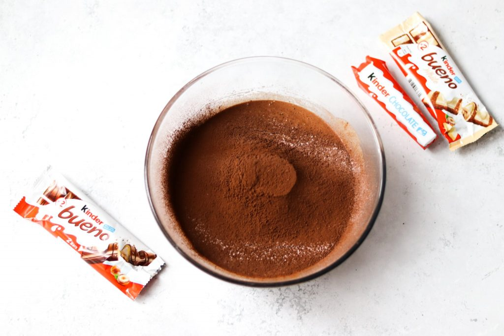 Sift plain flour and cocoa powder into mixing bowl