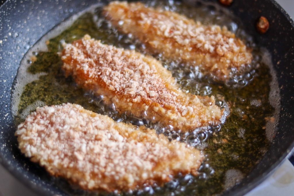 Southern flavoured chicken frying in oil