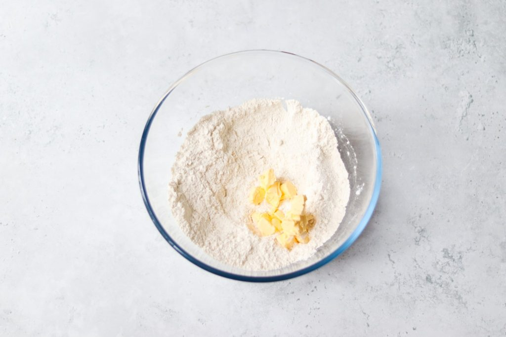 Cubes of butter added to flour